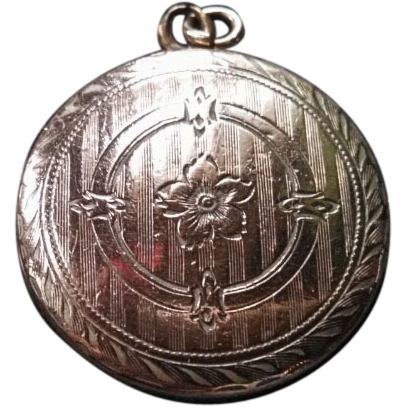Gold Victorian locket, floral engraved