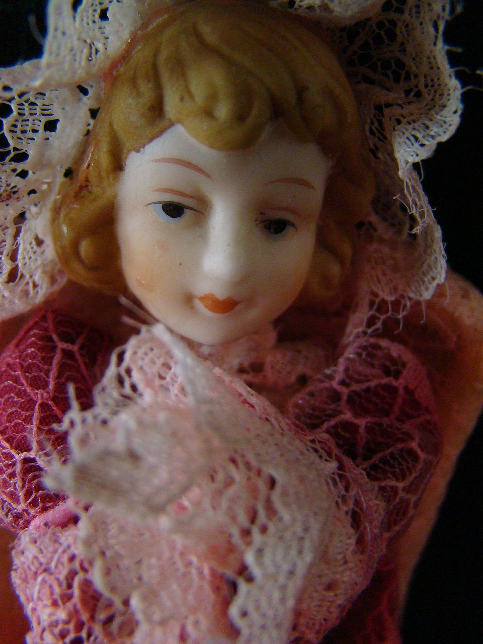 Victorian praying porcelain angel in fabric and lace