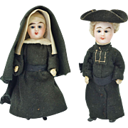 "Antique Mignonette Bisque Doll Pair Nun and Priest Glass Eyes 4.25"" Circa 1900"