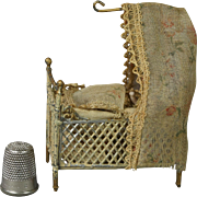"19th Century Miniature German Soft Metal Doll House Crib Canopy Cradle and Teeny Jointed 1.25"" Bisque Doll Circa 1890"