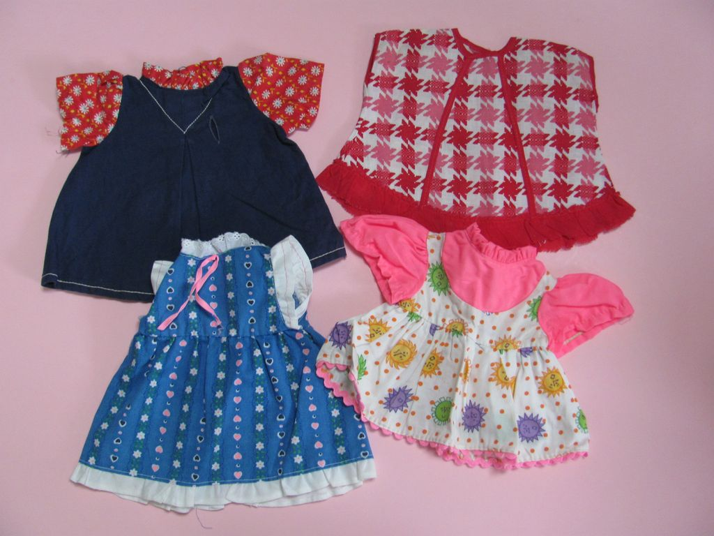 4 Vintage Factory Doll Dresses