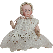 Gebruder Heubach Bisque Baby Doll With Extra Dress