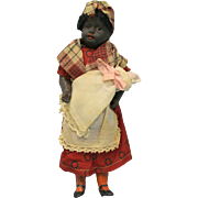 8 Inch Antique Kuhnlenz Black Mammy doll holding White bisque Baby All Original