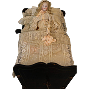 Antique Key Wind Automaton Mechanical Bisque Girl Doll in Old Cradle c.1890