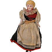 7 inch Original doll house doll in ethnic outfit, has bisque head,arms and legs