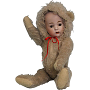 """Antique 12.5"""" Konig & Wernicke German Bisque Doll in Early mohair Teddy Bearsuit"""