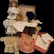 11inch Gebruder Heubach Glass eyed 7663 Laughing doll Trunk,exten.wardrobe Ex.Cond.