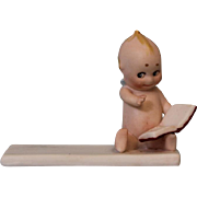 Antique Rose O'Neill Place Card Ca.1913 Bisque Kewpie Sitting Reading a Book