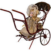 German automaton Bisque Doll in Bent wood buggy waves hands up and down and doll turns head from left to right All ORIGINAL clothes, paint etc.!