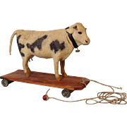 8 inch Tall 10 inch long Antique pull toy Milk Cow Felt covered,turn her Head She Mo's