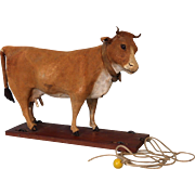 "8-1/2 inch T 11 inch L Antique pull toy Milk ""Cow"" Hide Covered Moo's Turn Head side to side"