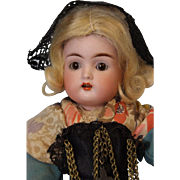13 inch French K * R Brown eyed girl with sleep eyes and orig French ethnic costume