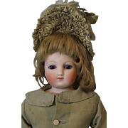 15 inch French bisque poupee/cobalt blue eyes & original poupee fashion body ca.1865
