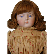 20 inch ABG Antique bisque doll w. human hair wig,cloth body & leather arms & feet