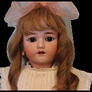 24 inch Henrich Handwerck German Bisque Doll with original clothes, brown sleep eyes