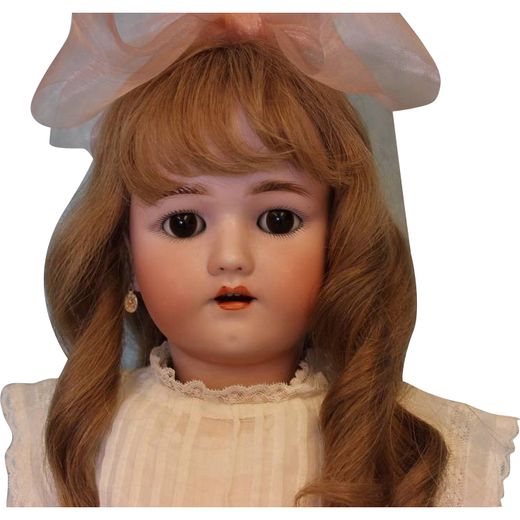 24 inch Henrich Handwerck German Bisque Doll with original clothes, brown sleep eyes