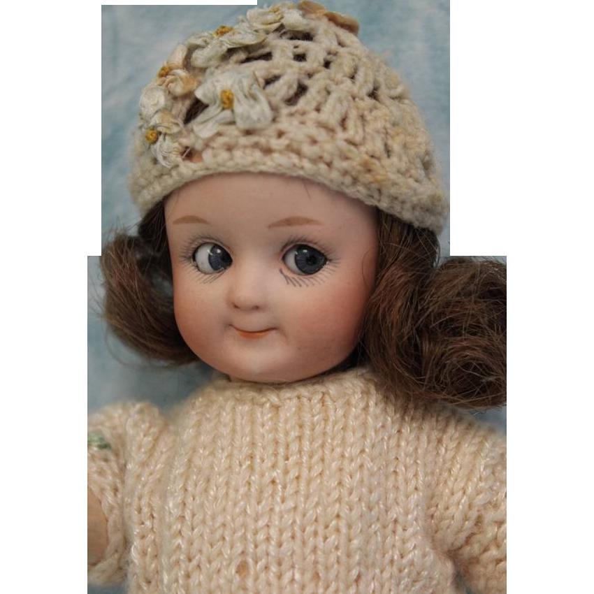 8 inch Antique Gebruder Heubach Googly doll with blue googly sleep eyes, toddler body