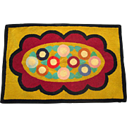 Colorful Yarn-Hooked Rug with Abstract Floral Design