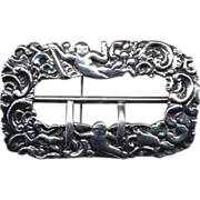 Cast Sterling Repousse Buckle Brooch with Cherubs