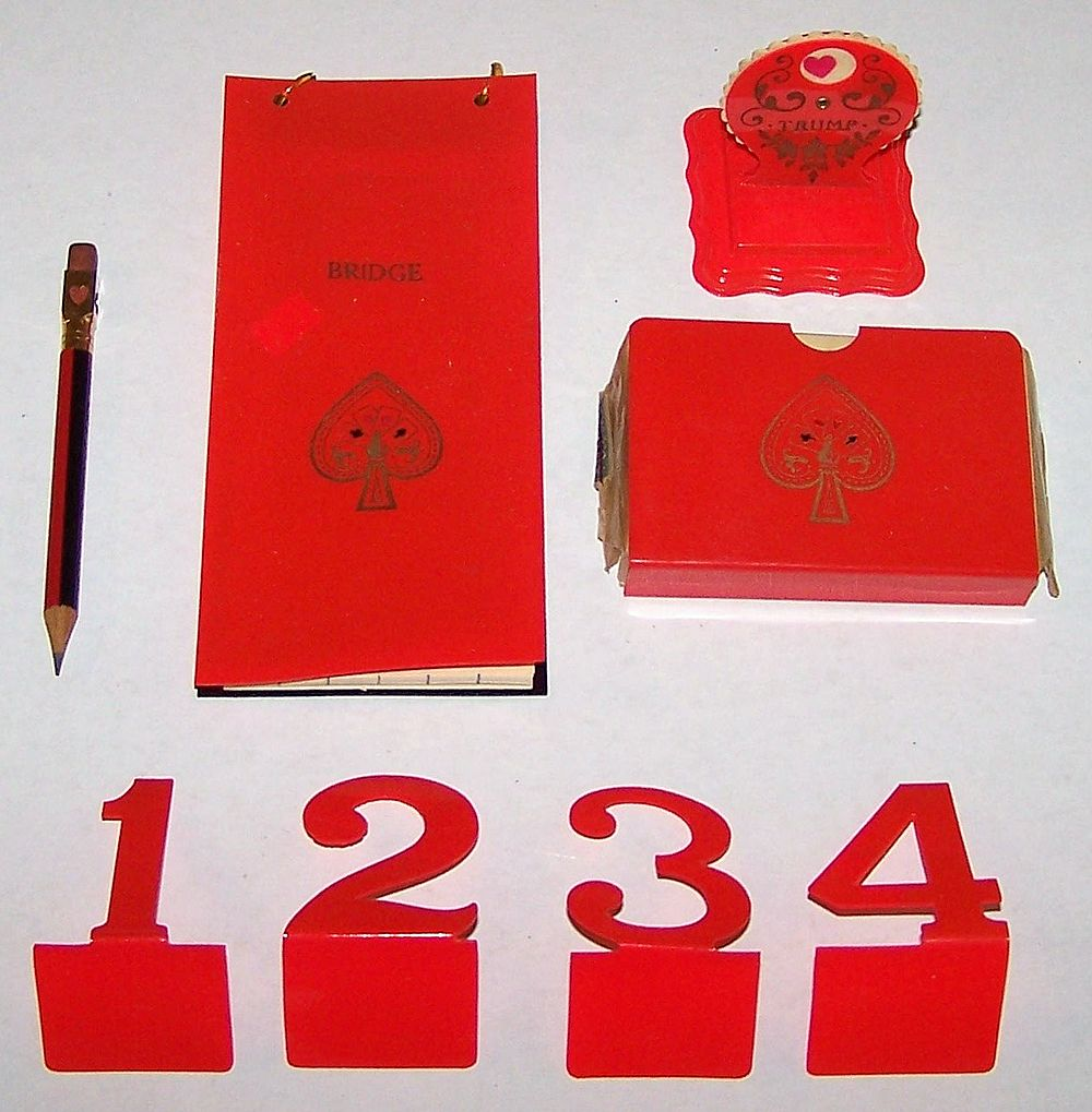 "Celluloid Auction Bridge Set w/ Standard ""Aviator"" Playing Cards, Card Holder, Covered Score Pad, Trump Indicator, Table Numbers (1-4), Eagle Pencil, c.1929"