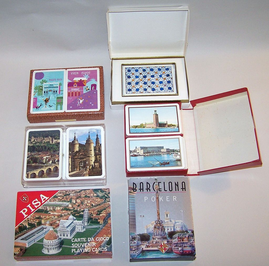 "6 Sets of Souvenir Playing Cards: Piatnik ""Virgin Islands/ Puerto Rico"" (2), Italcards ""Pisa"" (2), Naipes Comas ""Barcelona"" (1); Fournier ""Baraja Turistica"" (1); ASS ""Heidelberg"" (2); Oberg ""Swedish Castles"""