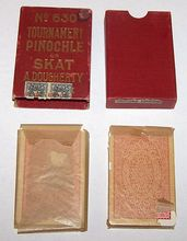 "Dougherty ""Tournament Pinochle or Skat No. 630"" Pinochle Set (2 x 32), ""Tournament Whist No. 63"" Cards, c.1923"