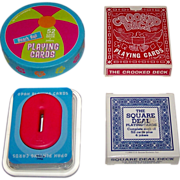 "4 Novelty Decks of Playing Cards, $10/ea.: (i) Two's Company Round ""Beach Ball""; (ii) A. Freed Novelty, Inc. ""Crooked Deck,"" c.1969; (iii)  Umbra ""Opah""; and (iv) Carta Mundi ""Square Deal Deck,"" (U.S. Games Systems), c.1990"