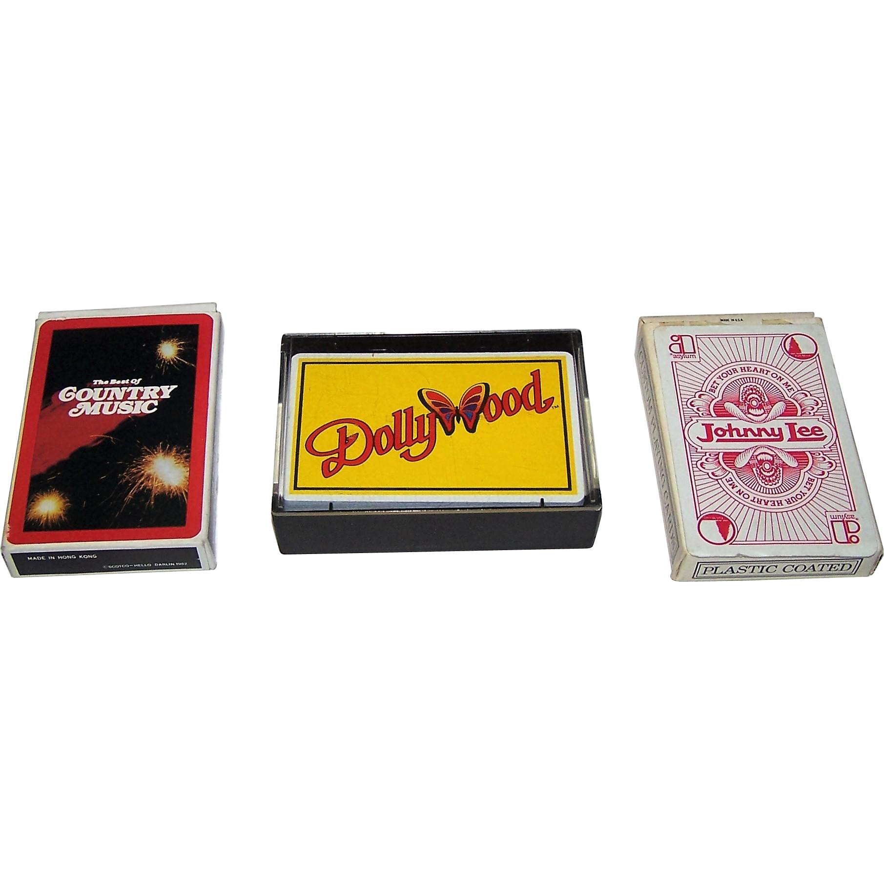 "3 Decks Country Music Playing Cards, $10/ea.: (i) Scotco – Hello Darlin ""The Best of Country Music,"" c.1982; (ii) Wiskur & Co., Inc. ""DollyWood"", c.1986; (iii) USPC (Liberty) ""Johnny Lee – Bet Your Heart on Me"", Asylum Records Publisher, c.1981"