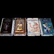 4 Sets Lo Scarabeo Tarot Cards, $15/ea.: (i) Ludy Lescot Tarot; (ii) Rameses Tarot of Eternity; (iii)  Tarot of the Dream Enchantress; and (iv) Universal Goddess Tarot