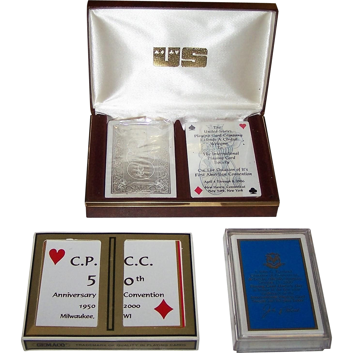 """3 Sets of Playing Card Collectors Club Cards, $10 ea.: (i) Double Deck USPC Bicycle for 1st IPCS Am. Convention, c.1986; (ii) Double Deck Gemaco for 50th Ann. Convention CPCC; and (iii) Carta Mundi for """"Playing Card History Day"""" – 1st Joi"""