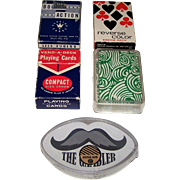 "5 Decks Novelty Cards, $10/ea.: (i)  Western ""Double Action"" (52/52, NJ), c.1935; (ii) Viscount ""Reverse Color""; (iii) Western/Whitman ""Vend-A-Deck,"" c.1960; (iv) Regal & Wade ""Kling Magnetic Steel""; and (v) ""The Gambler"" Mustache Shape"