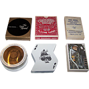 "3 Novelty Decks of Playing Cards, $15/ea.: (i) Honeywell ""The Year Round""; (ii) A. Freed Novelty, Inc. ""Crooked Deck,"" c.1969; and (iii) Pinellas County Industry Council ""Third Annual Aerospace Exhibition"" Playing Cards, 52 Different Backs, c.1964"