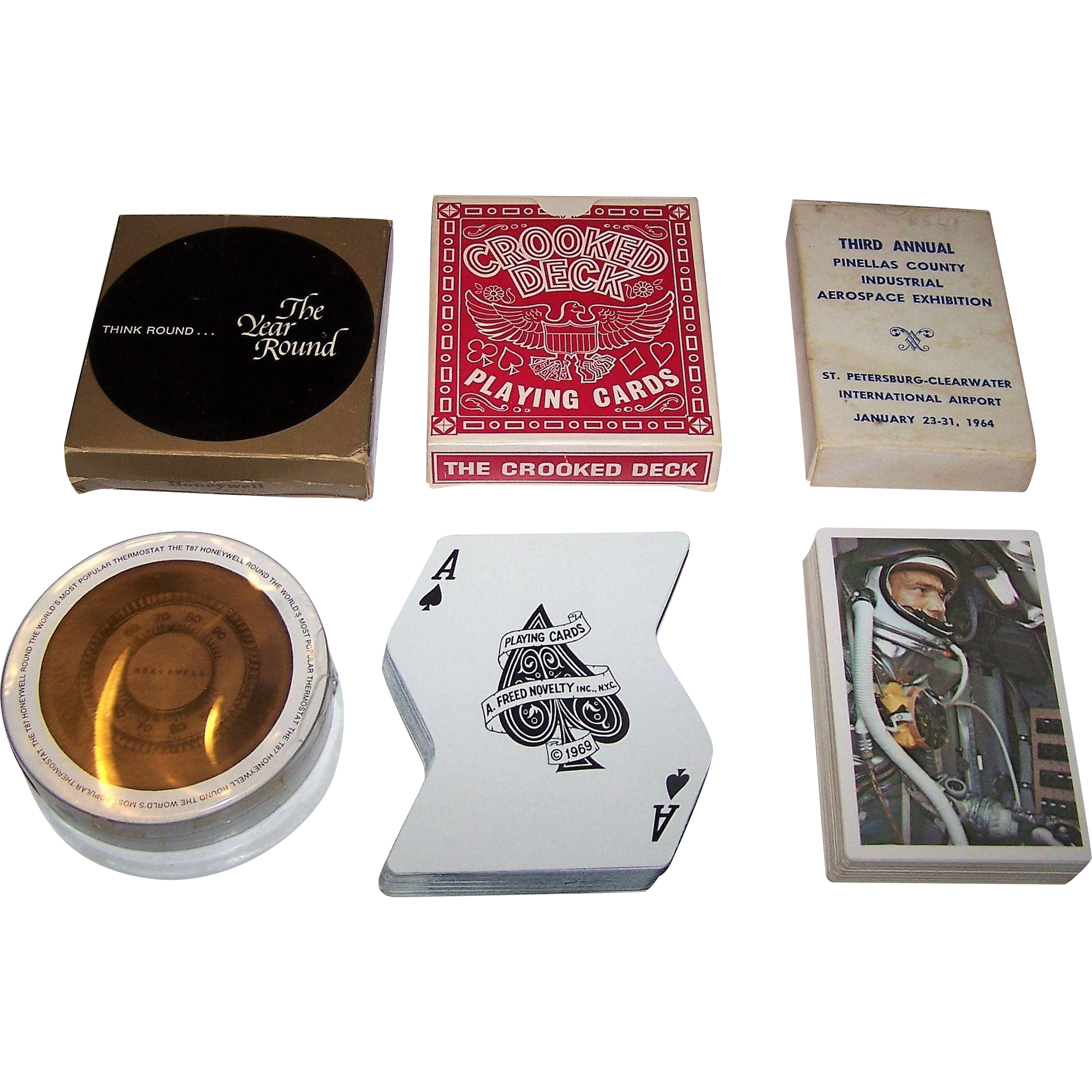 """3 Novelty Decks of Playing Cards, $15/ea.: (i) Honeywell """"The Year Round""""; (ii) A. Freed Novelty, Inc. """"Crooked Deck,"""" c.1969; and (iii) Pinellas County Industry Council """"Third Annual Aerospace Exhibition"""" Playing Cards, 52 Different Backs, c.1964"""