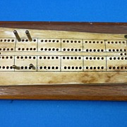Fossilized Bone cribbage board on wooden base
