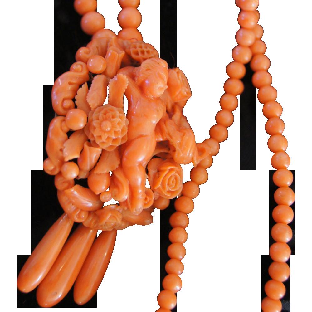 Victorian coral carved cherub pendant