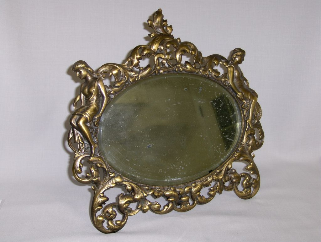 Antique Figural Mirror