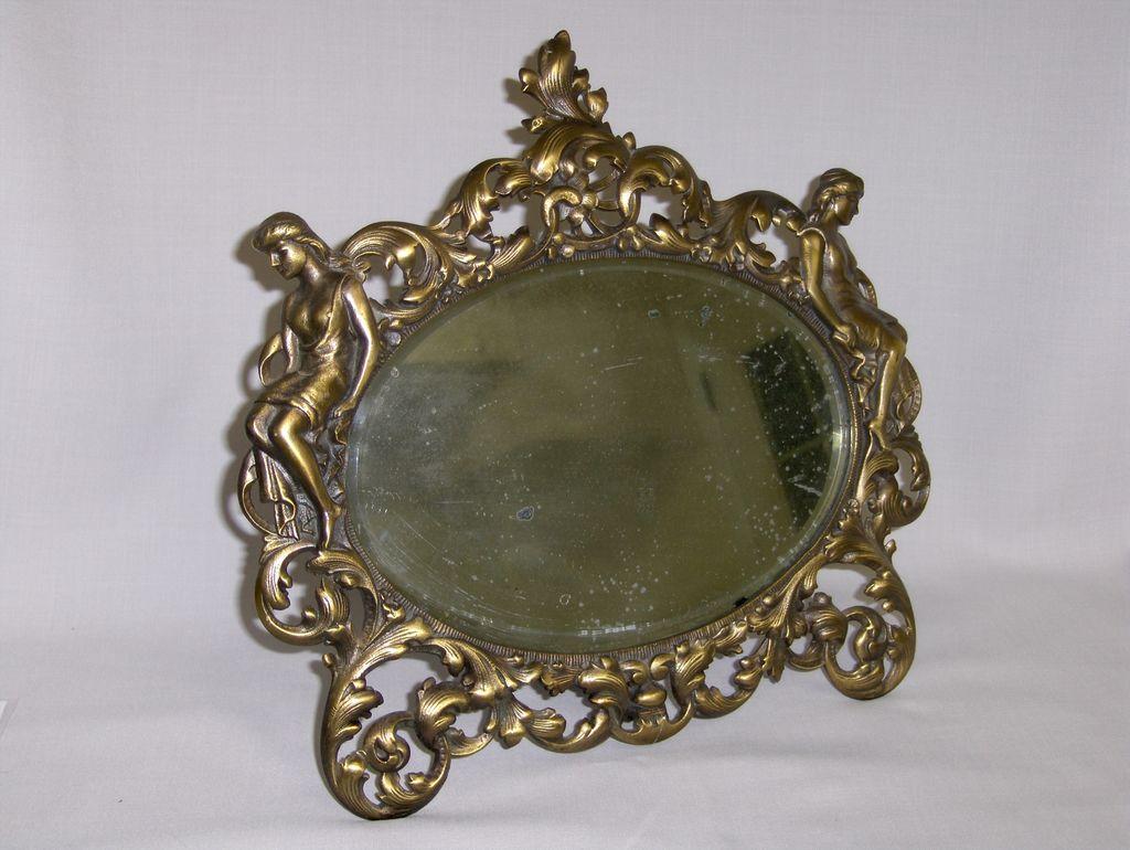 Antique Figural Mirror