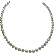 Vintage 6 Millimeter Cultured Pearl Princess Length Strand Necklace 14KWG Filigree Clasp