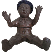 Figural metal baby for sewing implements and pincushion head