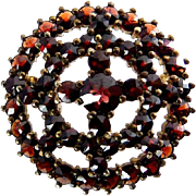 Victorian Bohemian Rose-Cut Garnet Round Pin with Cross, .900 Silver Gilt Setting