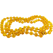 1920's Amber Yellow Glass Flapper Beads Knotted Necklace, 54 Inches