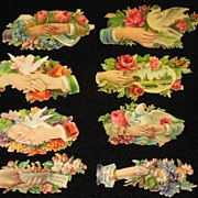 Eight Victorian Embossed Die Cuts with Hands, Roses, Flowers, Doves & Some Phrases-From 1886 Scrapbook