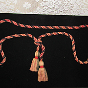 C. 1900's Faded Red & Black Braided Rope w/Tassels