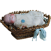 "Adorable 11"" Bye Lo Baby with Wicker Bassinet"