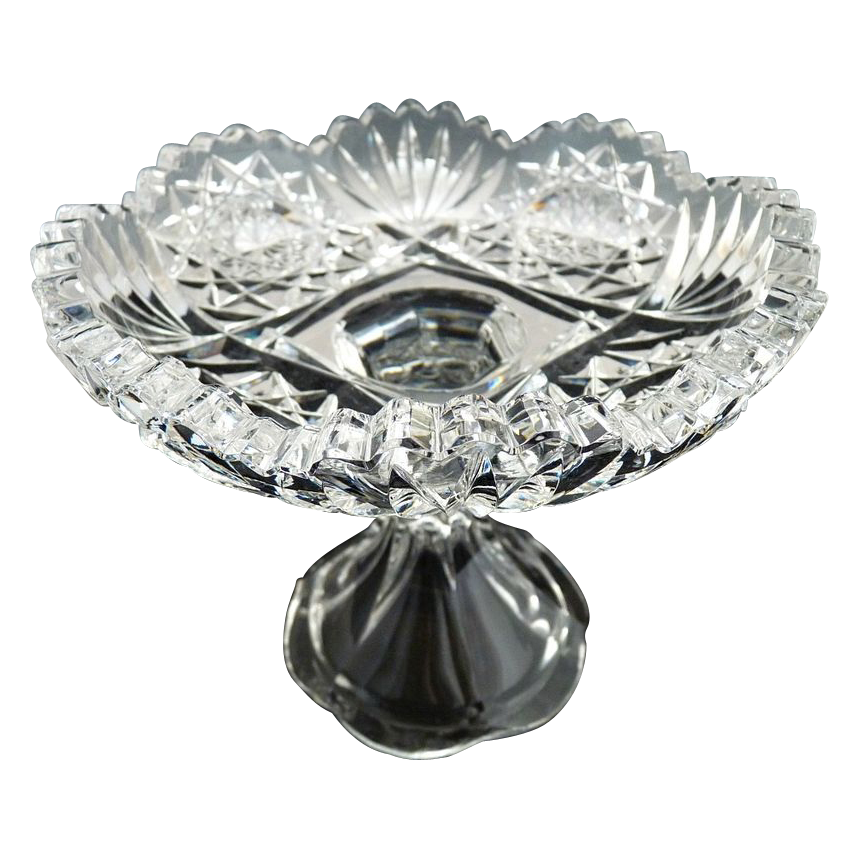 An antique cut glass pedestal compote sawtooth rim jelly dish