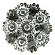 Vintage pressed glass butter pat starburst flower