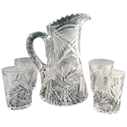 Cut Glass pitcher matching glasses starbursts etched stars