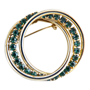 Vintage brooch intertwined circles green rhinestones