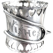 Antique silver napkin ring wishbone hearts Best wishes c. 1890s