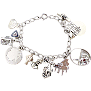 Vintage sterling charm bracelet school girl camp fire girls